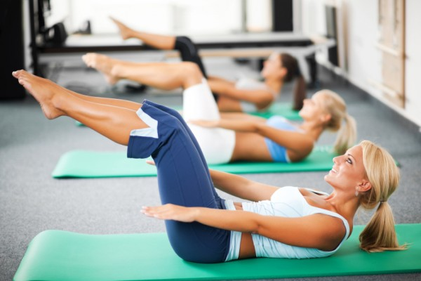 Three women sitting on the exercising mat and doing abdominal exercises.   [url=http://www.istockphoto.com/search/lightbox/9786738][img]http://dl.dropbox.com/u/40117171/group.jpg[/img][/url]  [url=http://www.istockphoto.com/search/lightbox/9786766][img]http://dl.dropbox.com/u/40117171/sport.jpg[/img][/url]